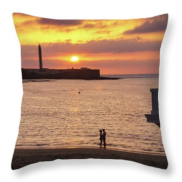 Throw Pillow featuring the photograph Couple At Sunset In La Caleta Cadiz Spain by Pablo Avanzini