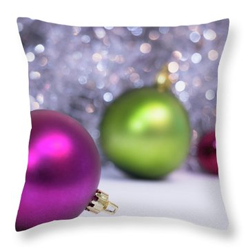 Throw Pillow featuring the photograph Festive Scene For Christmas With Xmas Balls And Lights In Backgr by Cristina Stefan