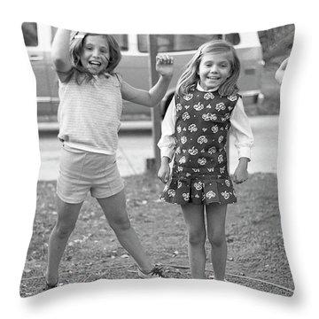 Four Girls, Jumping, 1972 Throw Pillow