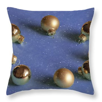 Golden Christmas Balls On The Snowy Background Throw Pillow