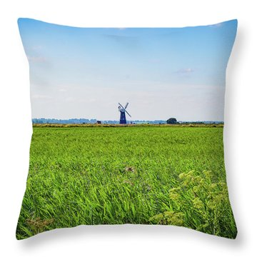 Throw Pillow featuring the photograph Green Grass Field With Windmill On Horizon by Scott Lyons
