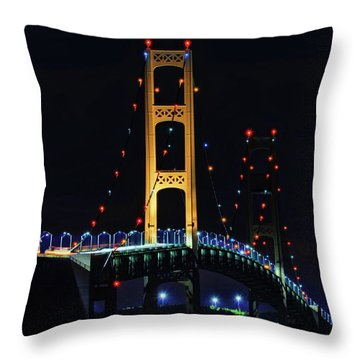 Throw Pillow featuring the photograph Mackinac Bridge Lit Up by Dan Sproul