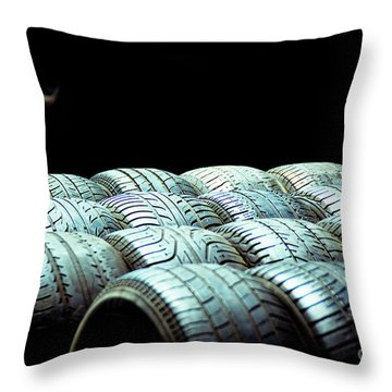 Old Tires And Racing Wheels Stacked In The Sun Throw Pillow