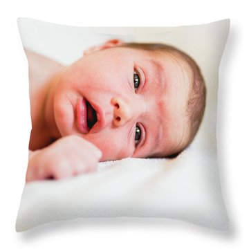 Portrait Of Newborn Baby Girl Feels Safe And Awake To A New Life. Throw Pillow