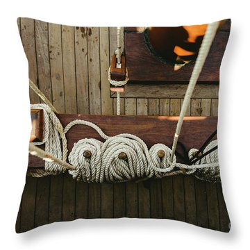 Ropes To Hold The Sails Of An Old Sailboat Rolled. Throw Pillow