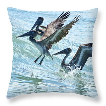 Wave Hopping Pelicans Throw Pillow