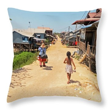 Young Girl Going Home - House On Stilts - Siem Reap, Cambodia Throw Pillow