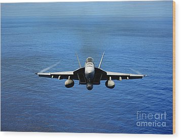 Wood Print featuring the photograph  A Fa-18 Hornet Demonstrates Air Power. by Paul Fearn