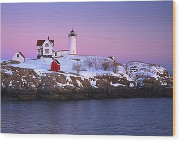 Nubble Light Under A Pastel Winter Sky Wood Print by Jeff Sinon