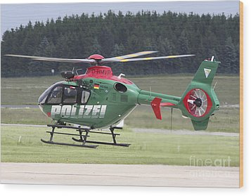 A Eurocopter Ec135 Used By German Wood Print by Timm Ziegenthaler