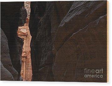 A Glimpse Of Al Khazneh From The Siq In Petra Jordan Wood Print by Robert Preston