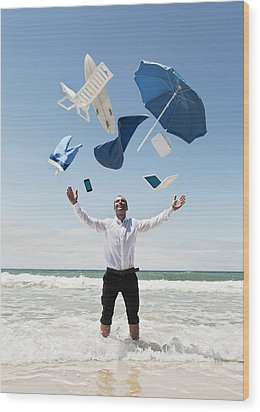 A Man Stands In The Ocean With Items Wood Print by Ben Welsh