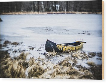 Canoe At The Frozen Lake Wood Print
