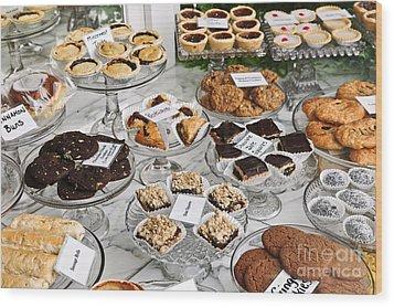 Desserts In Bakery Window Wood Print by Elena Elisseeva