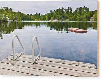 Dock On Calm Lake In Cottage Country Wood Print by Elena Elisseeva