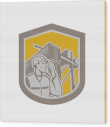 Dock Worker On Phone Container Yard Shield Wood Print by Aloysius Patrimonio