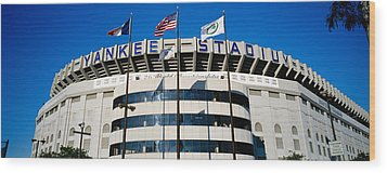 Flags In Front Of A Stadium, Yankee Wood Print by Panoramic Images