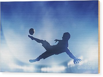 Football Soccer Match A Player Shooting On Goal Wood Print by Michal Bednarek