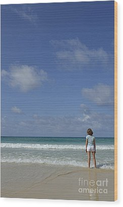 Girl Contemplating Ocean From Beach Wood Print by Sami Sarkis