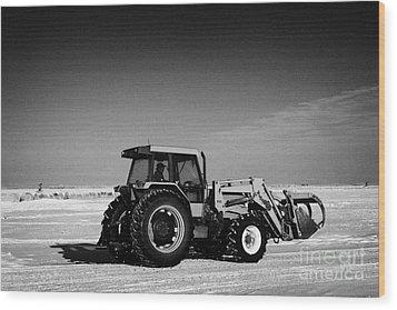 international 5140 tractor with front end loader on frozen field Forget Saskatchewan Canada Wood Print by Joe Fox