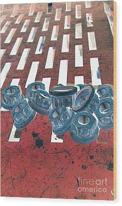 Lug Nuts On Grate Vertical Wood Print by Heather Kirk