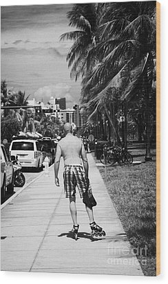 Man Rollerblading Along Ocean Drive Early Morning Art Deco District Miami South Beach Florida Usa Wood Print by Joe Fox