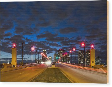Night Lights Wood Print by Debra and Dave Vanderlaan