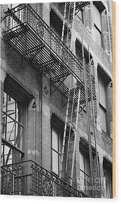Old Metal Fire Escape Staircase On Side Of Building Greenwich Village New York City Wood Print by Joe Fox