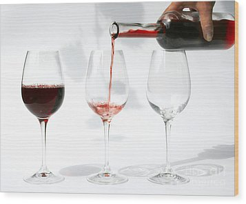 Pouring Red Wine Into Glass Wood Print by Patricia Hofmeester