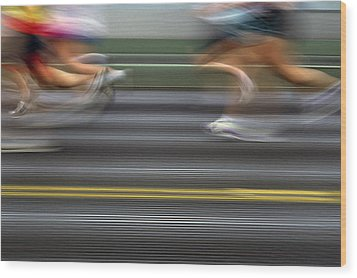 Runners Blurred Wood Print by Jim Corwin