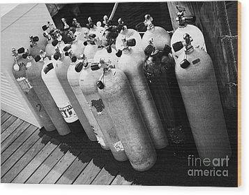 Scuba Air Tanks Lined Up On Jetty To Be Filled In Harbour Key West Florida Usa Wood Print by Joe Fox