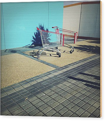 Shopping Trolleys  Wood Print by Les Cunliffe