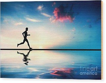 Silhouette Of Man Running At Sunset Wood Print