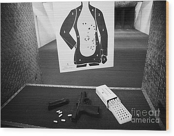 Smith And Wesson 9mm Handgun With Ammunition At A Gun Range Wood Print by Joe Fox