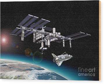 Space Station In Orbit Around Earth Wood Print by Leonello Calvetti