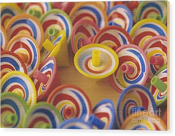 Spinning Tops Wood Print by Jim Corwin