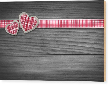 Two Hearts Laying On Wood  Wood Print by Aged Pixel