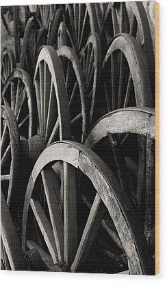 Wagon Wheels Wood Print by John Nelson