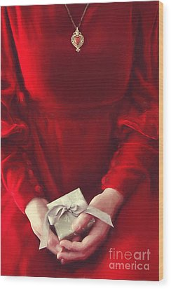 Wood Print featuring the photograph Woman In Red Dress Holding Gift/ Digital Painting by Sandra Cunningham