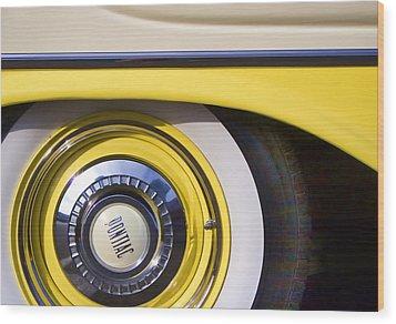 1957 Pontiac Starchief Wheel Cover Wood Print by Carol Leigh