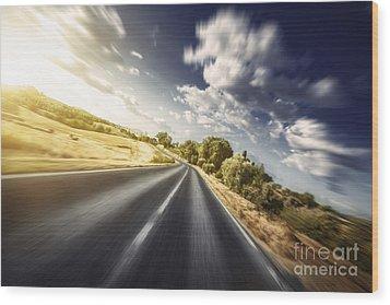 Asphalt Road In Field Against Moody Wood Print by Evgeny Kuklev