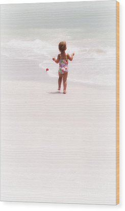 Baby Chases Red Ball Wood Print by Valerie Reeves