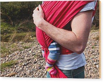 Baby Sling Wood Print by Tom Gowanlock