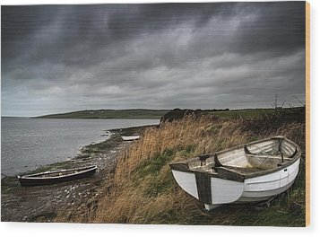 Old Decayed Rowing Boats On Shore Of Lake With Stormy Sky Overhe Wood Print by Matthew Gibson