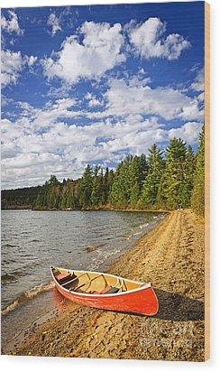 Red Canoe On Lake Shore Wood Print by Elena Elisseeva