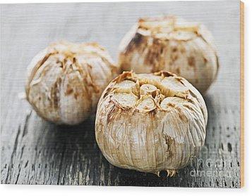 Roasted Garlic Bulbs Wood Print by Elena Elisseeva