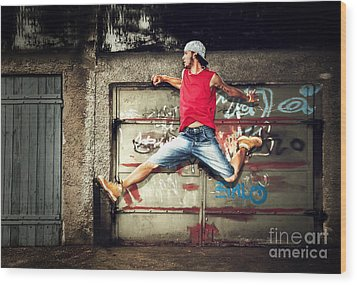 Young Man Jumping On Grunge Wall Wood Print by Michal Bednarek