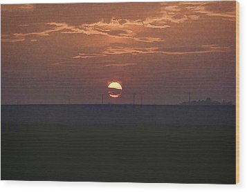 The Setting Sun In The Distance With Clouds Wood Print
