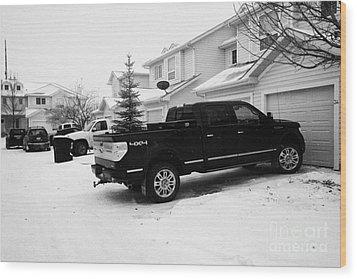 4x4 Pickup Trucks Parked In Driveway In Snow Covered Residential Street During Winter Saskatoon Sask Wood Print by Joe Fox