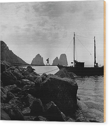 A Boat Docked At Capri Wood Print by Clifford Coffin